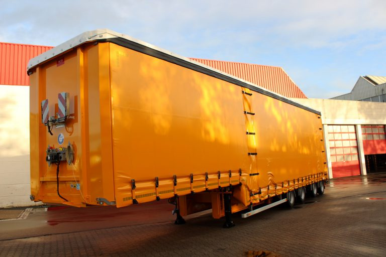 M.J VAN RIEL RELOCATES HEAVY MACHINERY WITH SPECIAL FLOOR STEPDECK TRAILER